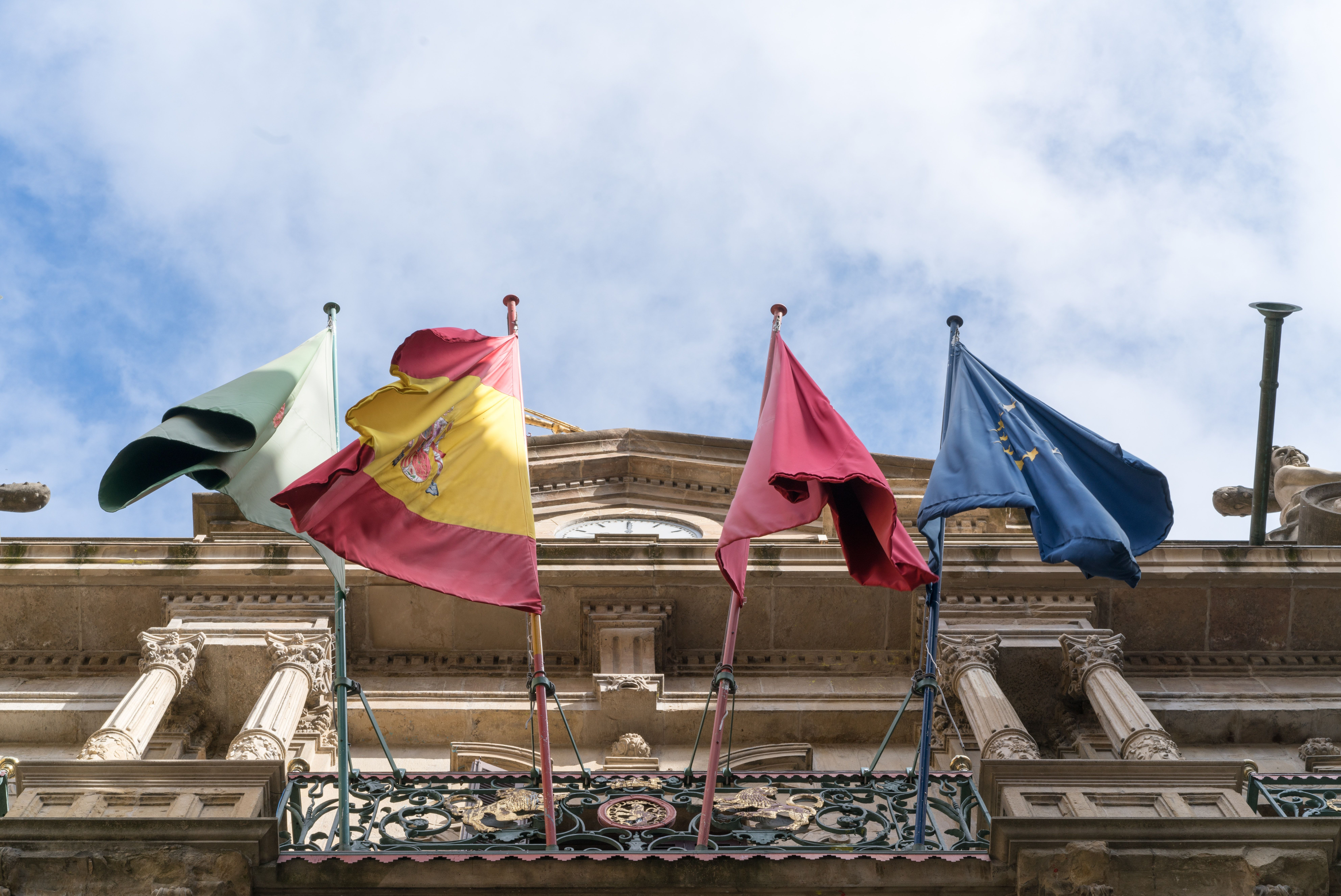 A photograph of four flags of european countries